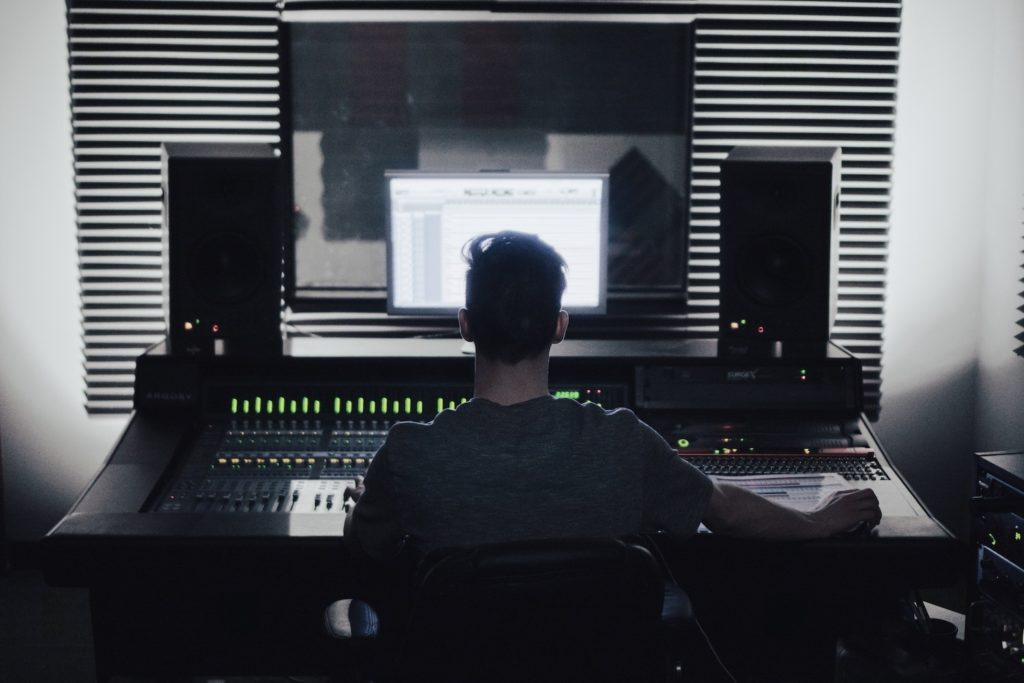 music producer sitting at a desk