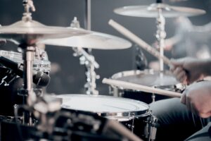 Drummer and drum set - learning how to increase the loudness of drums in your mix