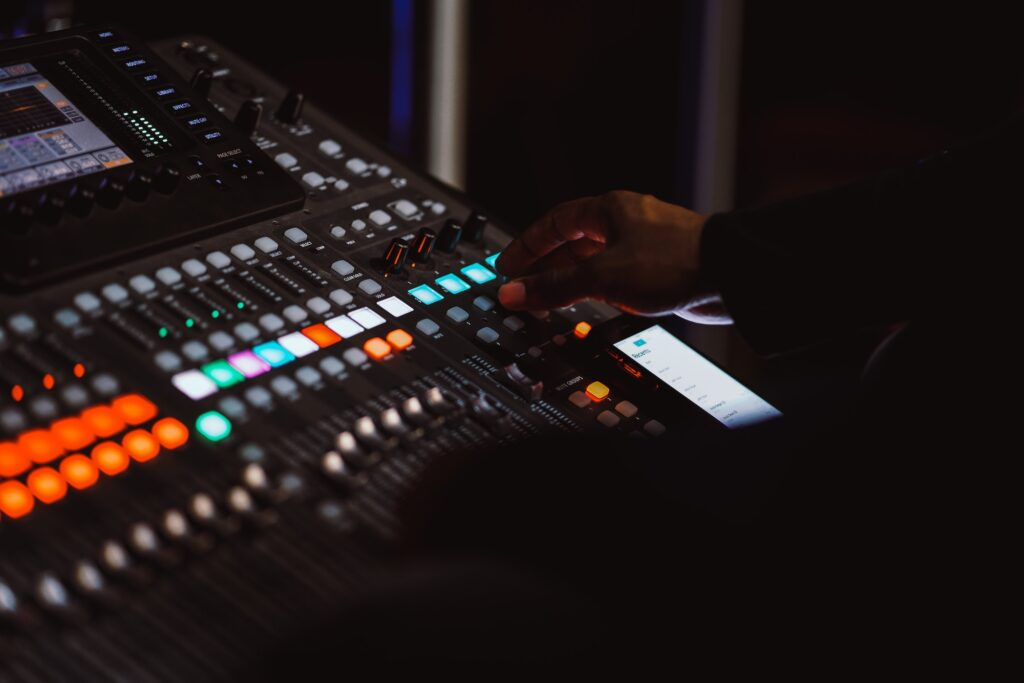 A music producer working on a mixer. Learn how to improve the quality of your mix